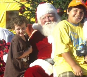 Photo of two boys with Santa to promote Winterfest Grandstand Tickets for Children