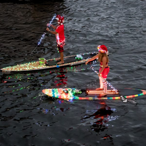 An image of a pair of Kayaks, Non-Motorized entries in the Winterfest Boat Parade