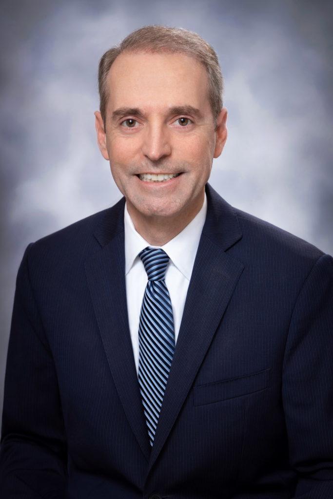 Board Member Shane Strum
