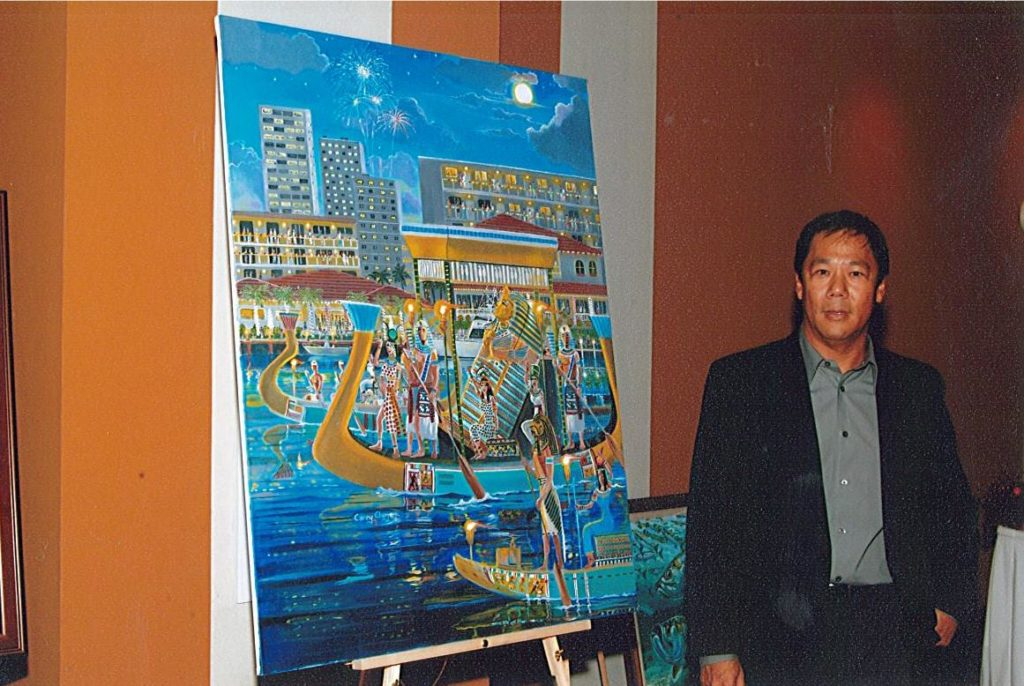"""Artist Carey Chen with his poster for the 2005 Winterfest Boat Parade """"Jewel of the Nile"""""""